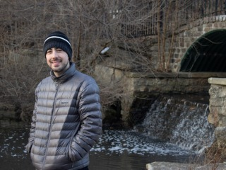 Nick Hunter in warm clothing near a spillway