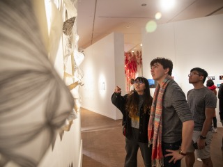 Guest discuss art hung on the Faulconer Gallery's wall