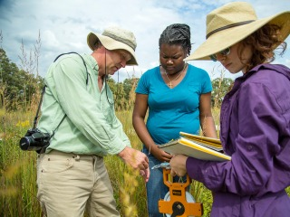 Professor and two students at Conard Environmental Research Area