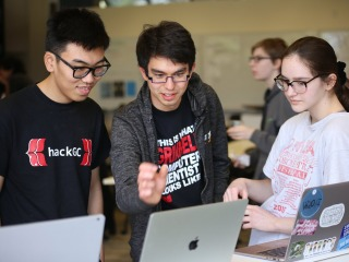 Three students collaborate in HackGC 2019