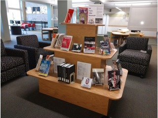 Display of books and media celebrating 50 Years After Stonewall riots