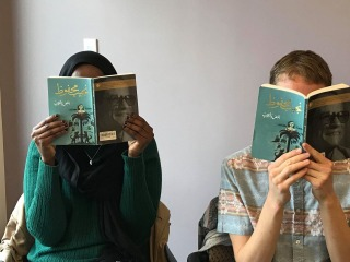 Farah Omer and Gray Streetman reading book, The Thief and the Dogs