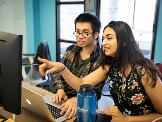 Ben Nguyen '19 and Ridhika Agrawal '20 working together at a computer