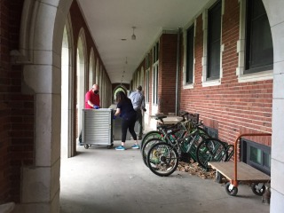 Americorps volunteers deliver meals in the loggia