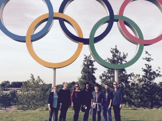Donna Vinter and students stand in front of Olympic Rings in London 2012