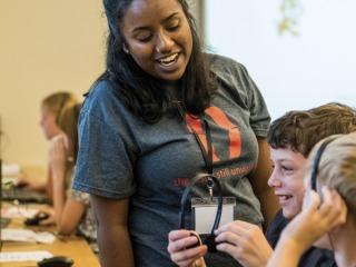 Syamala Neeraja '21 working with young students