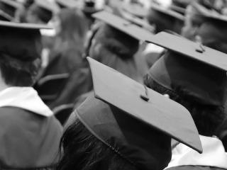 Students dressed in graduation regalia