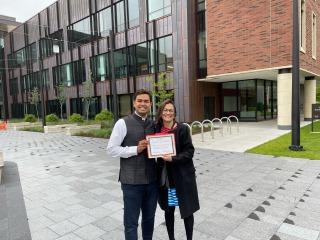 Sriyash Prajval Kadiyala '21 and professor Gemma Sala hold award outside HSSC