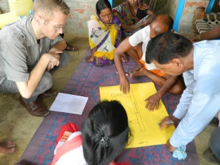 Anthony Wenndt in discussion with farmers in India