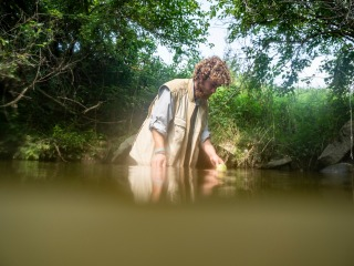 Tommy Hexter testing water conditions at Little Bear Creek