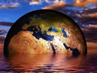 Earth globe in water
