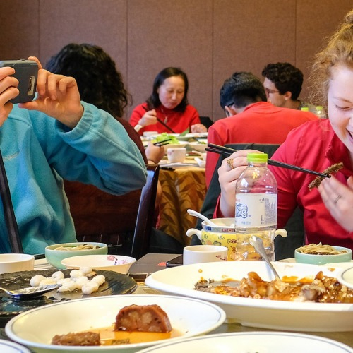 Students enjoy food in China