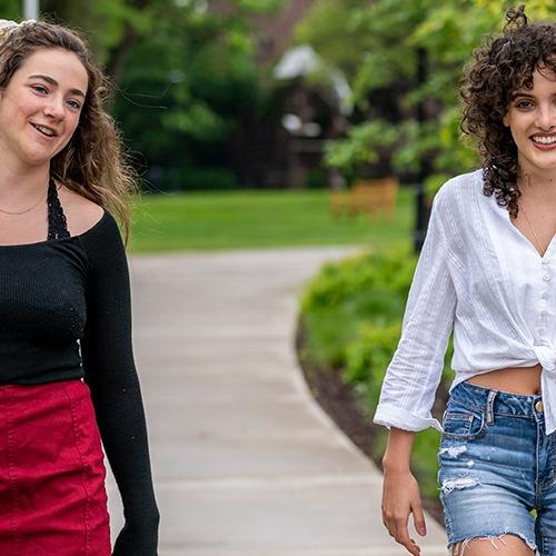 Lauren Miller '21 and Antonella Diaz '23 walking on campus