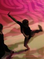 2 people dancing pink background