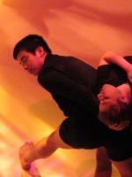 2 people dancing, yellow background