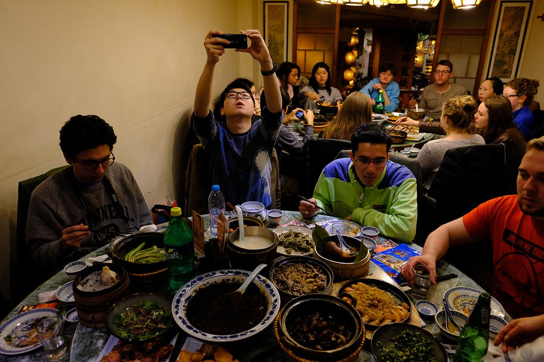 Students share dishes with family style dining