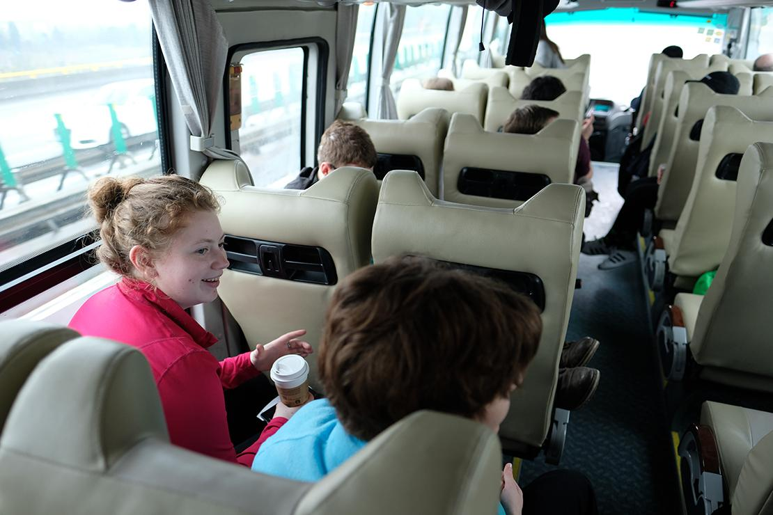Group riding on a coach bus