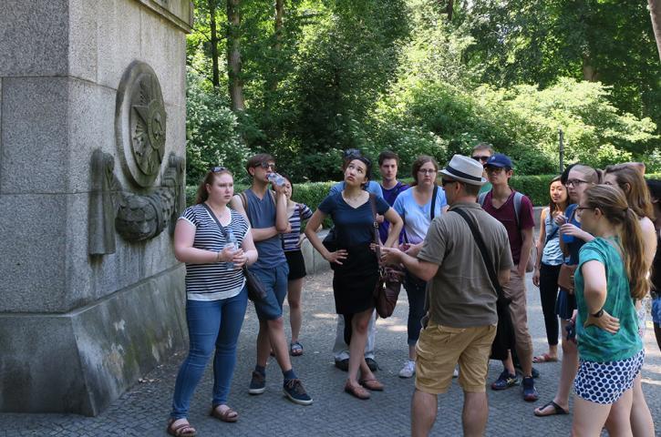 Dan Reynolds, professor of German, leads students through the entrance to Treptower Park, the Soviet soldier memorial in Berlin