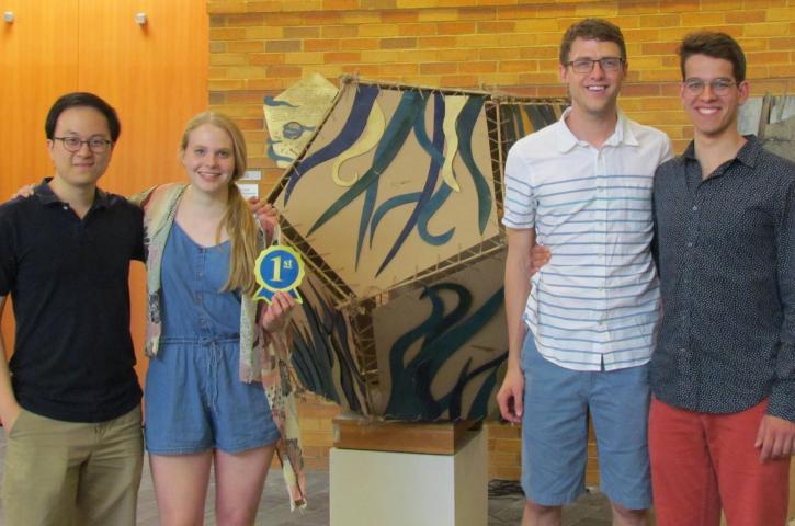 Hannah Davis, An Hoang, Ethan Huelskamp, Sasha Kuzura, Krit Petrachaianan, and Rachel Swoap pose with their winning sculpture