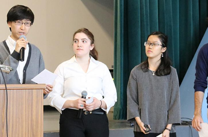 Four students give a presentation for Spark Tank