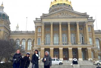 Students standing in front of the Iowa State Capitol
