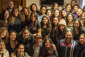 The Student Organization of Latinxs and alumni pose for a group photo