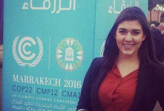 Teodora Cakarmis '17 poses in front of an exhibit at the Conference of the Parties on the United Nations Framework on Climate Change in Marrakech