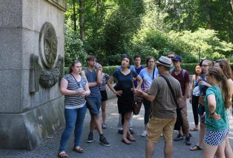Dan Reynolds, professor of German, leads students through the entrance to Treptower Park, the Soviet soldier memorial in Berlin