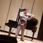 Andrew Gentzsch performing with his violin