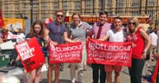 "Todd Foreman '95 (third from right) and supporters with ""lgbt Labour"" signs."