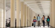 Students stroll down east campus loggia