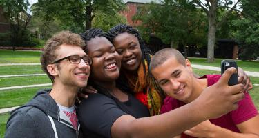 Karol Sadkowski '16, Fatu Drame '16, Queenster Nartey '16, and Greg Margida '16 take a group selfie