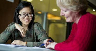 Trang Nguyen '17 (left) and Michele Regenold talking working together