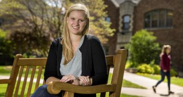 Natalie Duncombe '15 sitting on bench outdoors