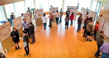 Students and visitors at poster session