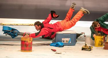 Actors appear to be sliding across ice in a rehearsal of the play Nice Fish.
