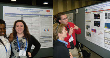 Students discuss their findings with others at the poster session.