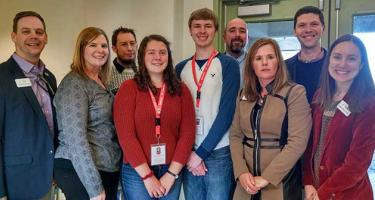 Group of national and local AmeriCorps involved in the visit