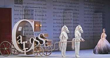 Cendrillon heading to the prince's ball in a coach made of the letters of the French word for coach