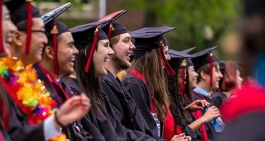 Graduates laugh during commencement ceremony