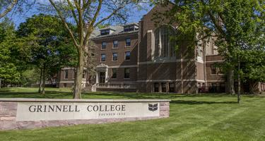 Grinnell College brick and stone sign in front of Main Hall