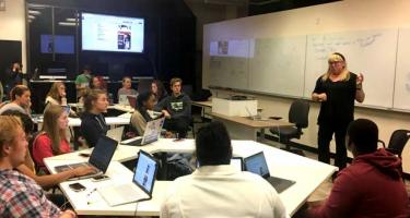 Class focused on professor in the digital lab