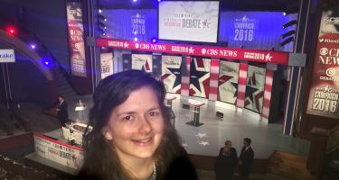 Emma Lange in front of the Democratic presidential debate stage before the event