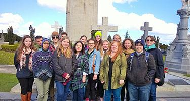 Group of students at Glasnevins Cemetery in Dublin, Ireland