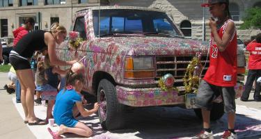 Children decorate Tilly Woodward's glitter truck during a Faulconer Gallery summer outreach activity in 2011.