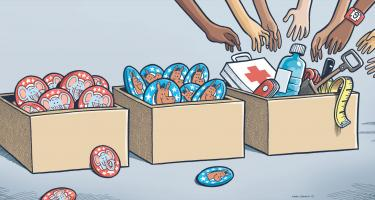 Boxes of Republican and Democrat buttons go ignored as hands reach into a box with first aid kit, water bottle, shovel, measuring tape and other supplies