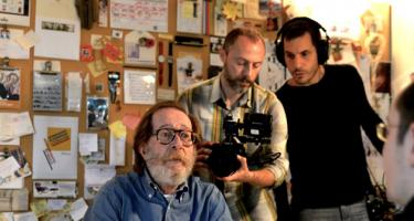 Production still from How to Steal a Chair, with director Konstantinos Kambouroglou and star Stergios Delialis, and others