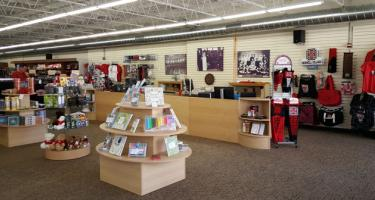 Interior of new Pioneer Bookshop, showing wide variety of books and Grinnell College gear.