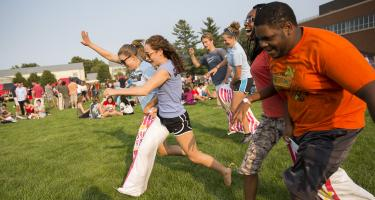 Students competing in three-legged race