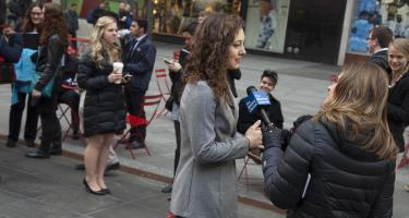 Woman being interviewed on the street